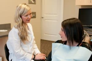 Dr. Kathryn providing emergency dental care