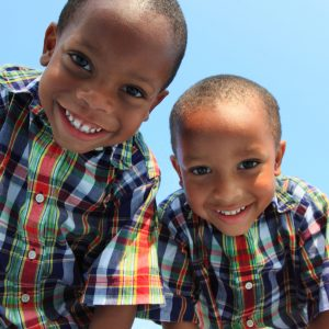 Image of 2 happy children who have seen a children's dentist in Lincoln, NE.