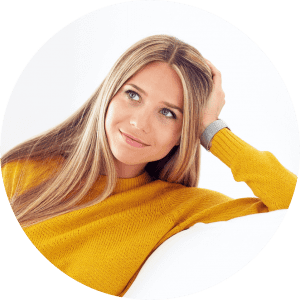 young woman thinking of dental topic